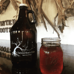 Twisted Roots cider and growler